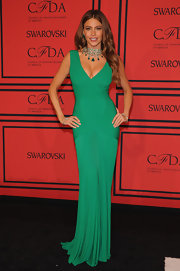 Sofia Vergara opted for a gown that would show off her curves when she wore this green V-neck draped dress.
