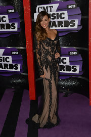 Jana Kramer's black lace overlay gown showed off her trim figure at the purple carpet of the 2013 CMT Music Awards.