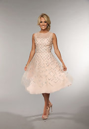 Carrie Underwood rocked a retro-inspired blush pink frock with silver beaded embellishments.