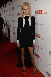Anja Rubik's black tuxedo-style frock gave her a cool boyish look on the red carpet.