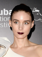 Rooney Mara stuck to her go-to hairstyle--the severe bun--when she attended the Dubai International Film Festival.