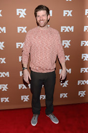 Stephen Rannazzisi chose a bright coral crewneck for her casual but cozy red carpet look.