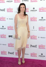 Linda Cardellini opted for a soft and flowy cream cocktail dress for her Independent Spirit Award look.