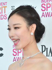 Ziyi Zhang opted for a classic look with a low French Twist at the Independent Spirit Awards.