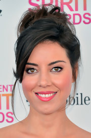 Aubrey Plaza mixed old-school glamour with a modern relaxed look with her slightly 'undone' updo.