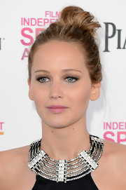 Jennifer Lawrence rocked an edgier look at the Independent Spirit Awards with a messy top knot.
