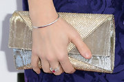 Melanie Lynskey added some sparkle to her look at the Independent Spirit Awards with this nude colored crystal clutch.