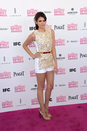 Nina Dobrev looked casual and cool at the Independent Spirit Awards with a textured gold top and complementary belt.