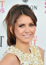 Nina Dobrev opted for a high, loose ponytail for her more casual and comfy look at the Independent Spirit Awards.