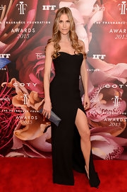 Annelise Peterson chose a simple but sexy strapless black dress with a thigh-high front slit.