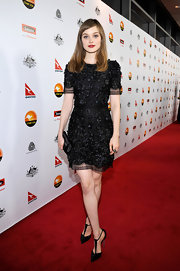 Bella Heathcote accessorized her textured LBD with inky T-strap Casadei pumps.