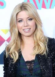 Jennette McCurdy left her hair loose with a center part and pretty waves when she attended the HALO Awards.