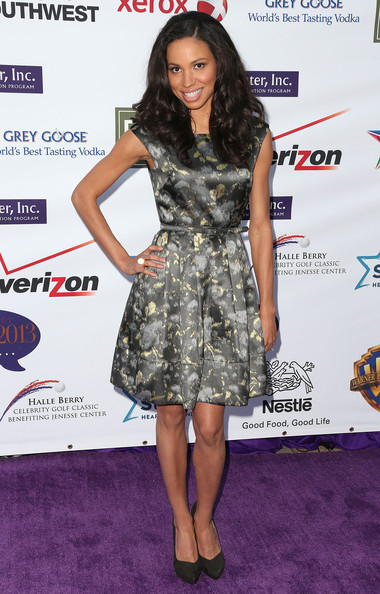 Jurnee Smollett-Bell chose a gray and gold satin frock with a delicate watercolor print.