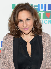 Kathy Najimy chose a bright pastel pink lip color to add some fun and whimsy to her red carpet look at the Joyful Heart Foundation Gala.