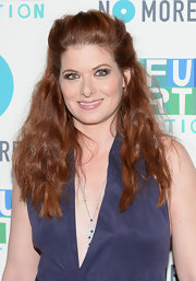 Debra Messing pulled backer her fiery red locks into this edgy half up, half down teased 'do.