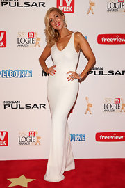 Catriona Rowntree chose a figure-hugging white gown for her sleek and modern red carpet look.