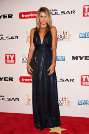 Jesinta Campbell sparkled on the red carpet when she chose this evening blue gown, featuring a plunging neck.