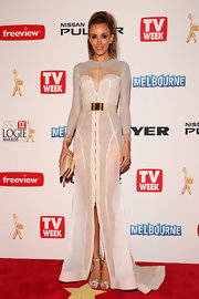 Rebecca Judd chose a very contemporary look when she opted for this sheer white gown, featuring long sleeves, an illusion neck, and a belted waist.