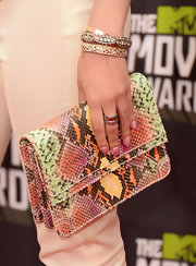 Bella Thorned added a touch of color to her cream pantsuit when she rocked this multi-colored snakeskin clutch.
