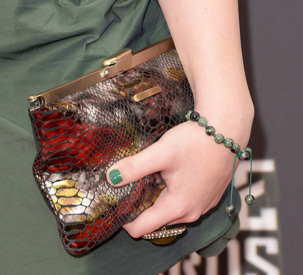 Vanessa Marano brought some color to her red carpet look with this red, gold, and silver leather clutch.