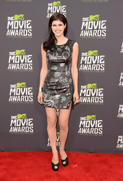 Alexandra Daddario chose a sleek metallic, printed dress for her cool and contemporary red carpet look at the 2013 MTV Movie Awards.