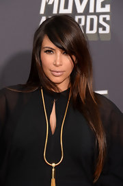 Kim Kardashian rocked a simple nude lipstick, which topped off her glowing red carpet look.