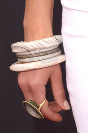 Jordana Brewster chose white bangle bracelets to top off her crisp red carpet look.