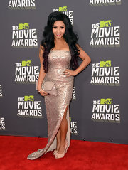 Nicole 'Snooki' Polizzi glammed it up at the 2013 MTV Movie Awards, where she rocked this strapless beaded gown.