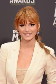 Bella Thorne rocked a more natural beauty look with a nude-colored lip gloss.