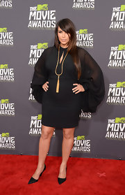 Kim Kardashian rocked a bohemian-inspired keyhole neck dress with flowing sleeves for her look at the 2013 MTV Movie Awards.