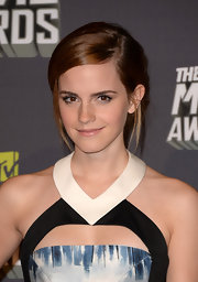 Emma Watson chose a sleek bobby-pinned 'do to top off her natural and effortless red carpet look.