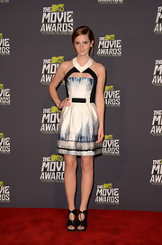 Emma Watson rocked a subtle but sleek halter dress with a cool neck cutout detail.