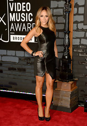 Melissa hit the red carpet of the VMAs sporting a black zip-up leather dress.