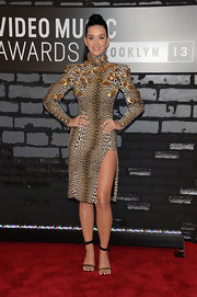 Katy brought out her wild side with this leopard-print long-sleeve dress with gold feather embellishments, which she wore to the 2013 VMAs.