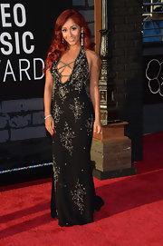 Nicole 'Snooki' Polizzi chose a black dress with silver floral embroidery and a deep V-neck for her look at the VMAs.