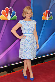 Amy kept her look preppy and flirty with this powder blue printed dress and matching belt.
