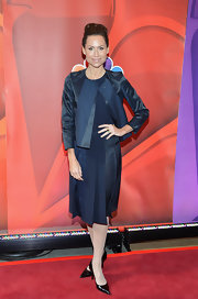Minnie Driver opted for a midnight blue pleated dress with a matching box-shaped blazer for her red carpet look.
