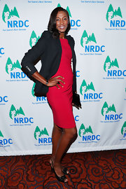 Lisa Leslie paired a classic black blazer with her red cocktail dress for a sleek but casual red carpet look.