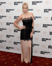 Genevieve Morton looked classic and elegant in a beige and black lace-panel evening dress at the New York City Opera Spring Gala.