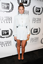 Adele Exarchopoulos sported a bold silhouette in a pale blue Balmain blouse during the NY Film Critics Circle Awards.
