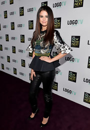 Selena Gomez chose a pair of black leather pants to pair with her printed peplum top for a sleek and modern look.