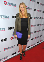 Jennifer Finnigan paired a deep forest green leather jacket over her black top and matching pencil skirt.