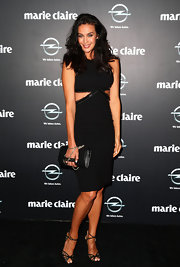 Megan Gale sported a slinky black dress with mirroring cutouts on the side.