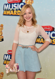 An A-line denim skirt gave Dove Cameron a cool and casual red carpet look.