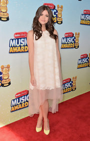 Maia Mitchell looked lovely in this lace frock that featured a sheer blush overlay.