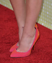 Olivia Holt showed off her funky style with these orange and pink heels with cool dotted studs.