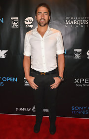 Janko Tipsarevic kept his red carpet look simple and chic with a white button down paired with black plants.