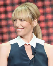 Toni Collette chose a teased low ponytail with face-framing bangs for her look at the 2013 Summer TCA tour.