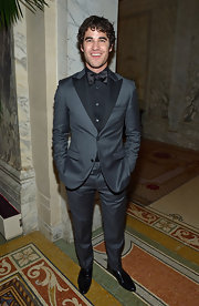 Darren Criss wore a charcoal gray suit with black peak lapels over a black button down and tie at the 2013 Tony Awards.