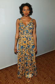 Condola Rashad chose this yellow and blue floral print maxi for her look at the Tony Awards Nominees Reception.
